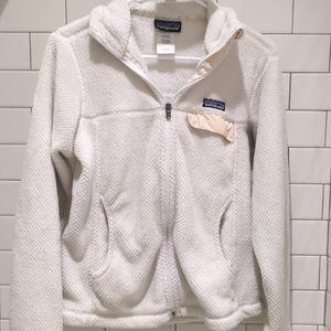 white Patagonia zip up jacket